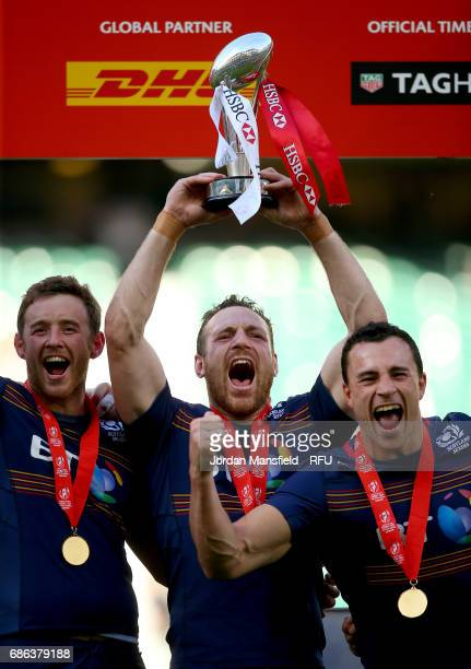 Scott Riddell of Scotland lifts the trophy after winning their Final match against England during day two of the HSBC London Sevens at Twickenham...