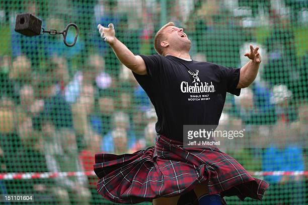 Scott Rider competes during the heavy weight competition at the Braemar Highland Games at The Princess Royal and Duke of Fife Memorial Park on...