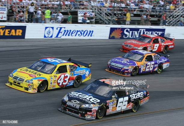 Scott Riggs driver of the State Water Heaters Chevrolet races with Bobby Labonte driver of the Cheerios Racing/Betty Crocker Dodge Jamie McMurray...