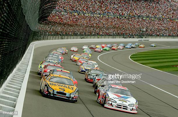 Scott Riggs , driver of the Valvoline/Stanley Tools Dodge and Matt Kenseth , driver of the DeWalt Ford, lead the field at the start of the NASCAR...