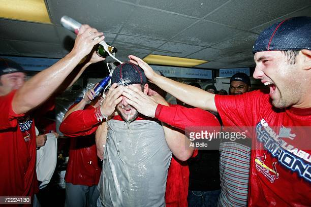 Scott Rolen and Jeff Suppan of the St Louis Cardinals celebrate in the locker room after defeating the New York Mets 3 to 1 in game seven of the NLCS...