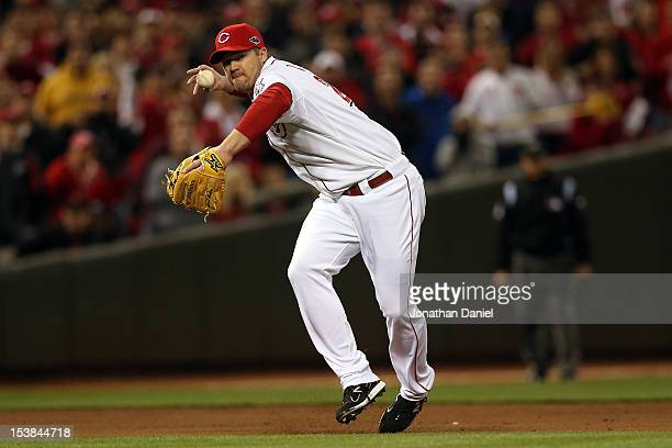 Scott Rolen of the Cincinnati Reds makes an error at third base on a ball hit by Joaquin Arias of the San Francisco Giants allowing the eventual...