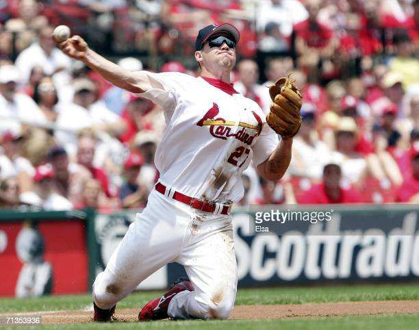 Scott Rolen of the St Louis Cardinals fields the ball and sends it to first for the out against the Kansas City Royals on July 2 2006 at Busch...