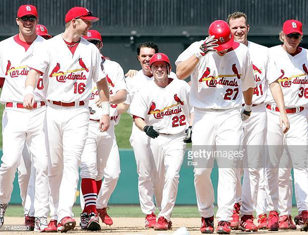 Scott Rolen of the St Louis Cardinals is congratulated by teammates after he hit a gamewinning RBI single to drive in David Eckstein in the bottom of...