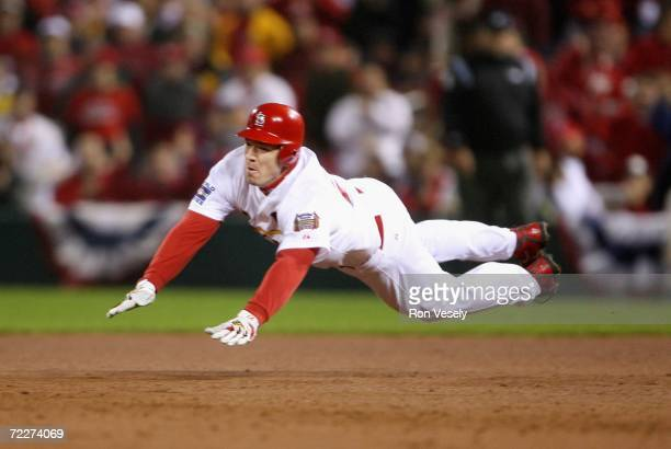 Scott Rolen of the St Louis Cardinals slides into second base after hitting a double against the Detroit Tigers during the fourth inning of Game Four...
