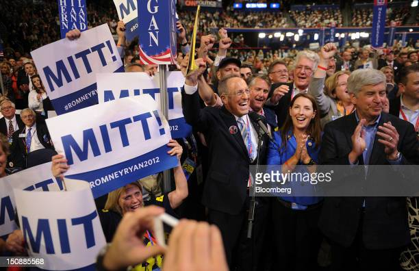 Scott Romney brother of Republican presidential candidate Mitt Romney center and Ronna Romney McDaniel committeewoman for the Michigan Republican...