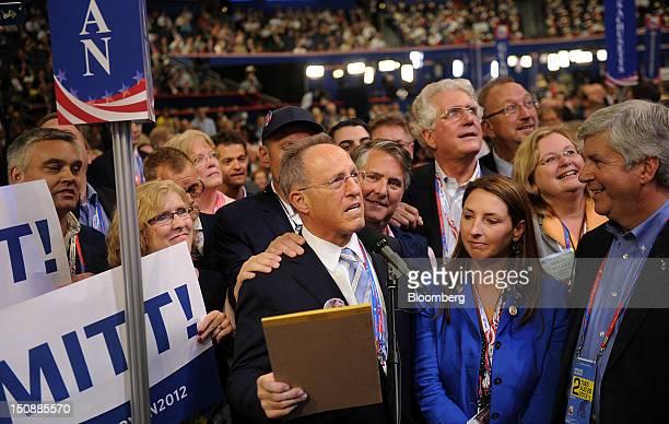Scott Romney brother of Republican presidential candidate Mitt Romney center announces Michigan's choice for presidential candidate while Ronna...