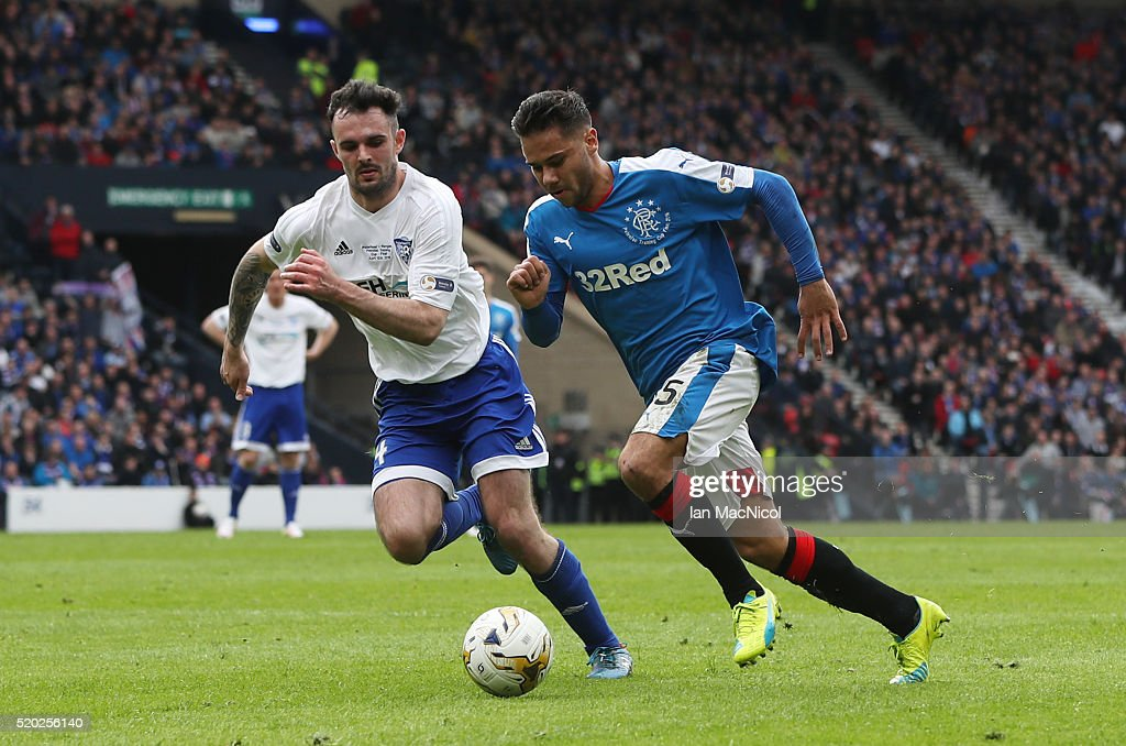 Scott Ross of Peterhead vies with Harry Forrester of Rangers during the Petrofac Training Cup Final between Rangers and Peterhead at Hampden Park on April 10, 2016 in Glasgow, Scotland.