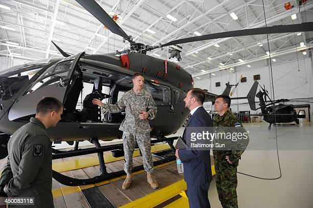 CW4 Scott Sauer Maryland National Guard talks about the LUH72 Lakota helicopter as Tanel Sepp Deputy Chief of Mission and Col Aivar Salekesin...