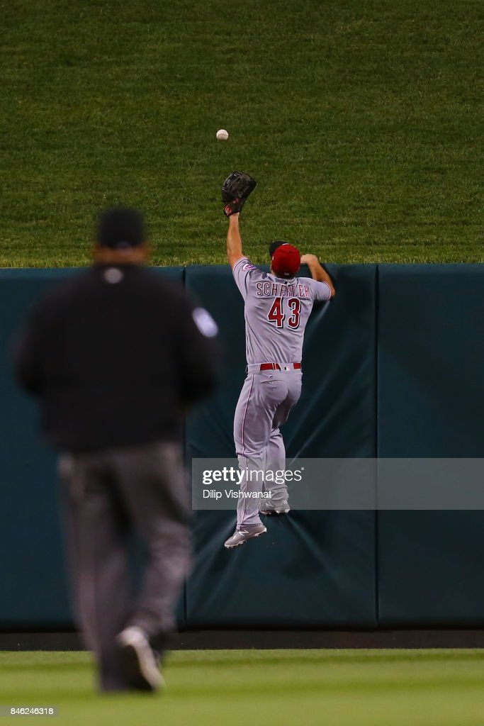 Scott Schebler #43 of the Cincinnati Reds attempts to make a catch against the St. Louis Cardinals in the sixth inning at Busch Stadium on September 12, 2017 in St. Louis, Missouri.