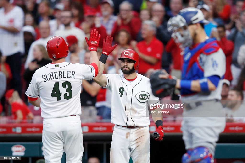 Scott Schebler #43 of the Cincinnati Reds celebrates with Jose Peraza #9 after hitting a solo home run in the third inning of the game against the Los Angeles Dodgers at Great American Ball Park on September 11, 2018 in Cincinnati, Ohio. The Reds won 3-1.