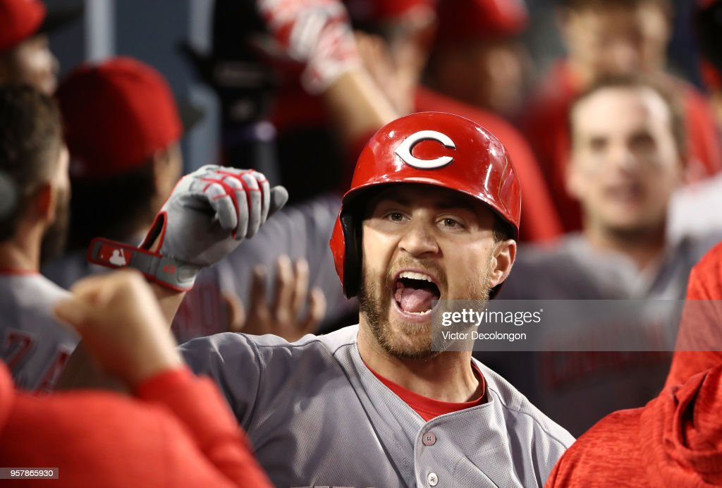 Scott Schebler #43 of the Cincinnati Reds celebrates with teammates in the dugout after hitting a three-run homerun to take a 4-3 lead in the sixth inning of the MLB game against the Los Angeles Dodgers at Dodger Stadium on May 12, 2018 in Los Angeles, California. The Reds defeated the Dodgers 5-3.