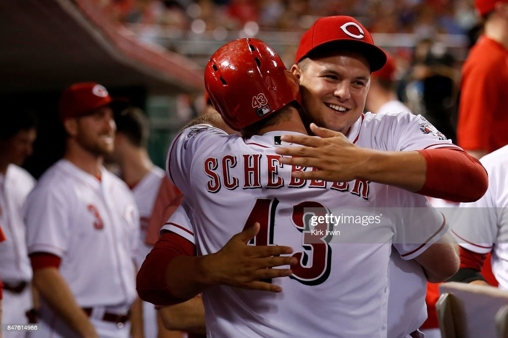 Scott Schebler #43 of the Cincinnati Reds is congratulated by Sal Romano #47 of the Cincinnati Reds after hitting a home run during the fifth inning of the game against the Pittsburgh Pirates at Great American Ball Park on September 15, 2017 in Cincinnati, Ohio. Cincinnati defeated Pittsburgh 4-2.
