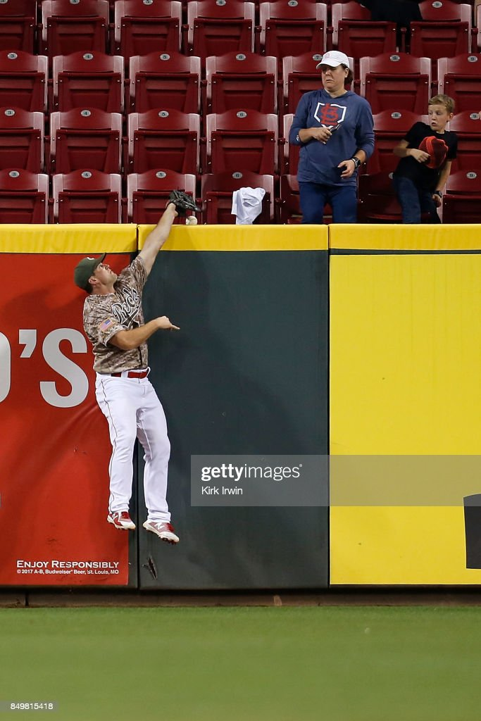 Scott Schebler #43 of the Cincinnati Reds is unable to make the catch, resulting in a home run to tie the game hit by Dexter Fowler #25 of the St. Louis Cardinals during the eighth inning at Great American Ball Park on September 19, 2017 in Cincinnati, Ohio. St. Louis defeated Cincinnati 8-7 in ten innings.