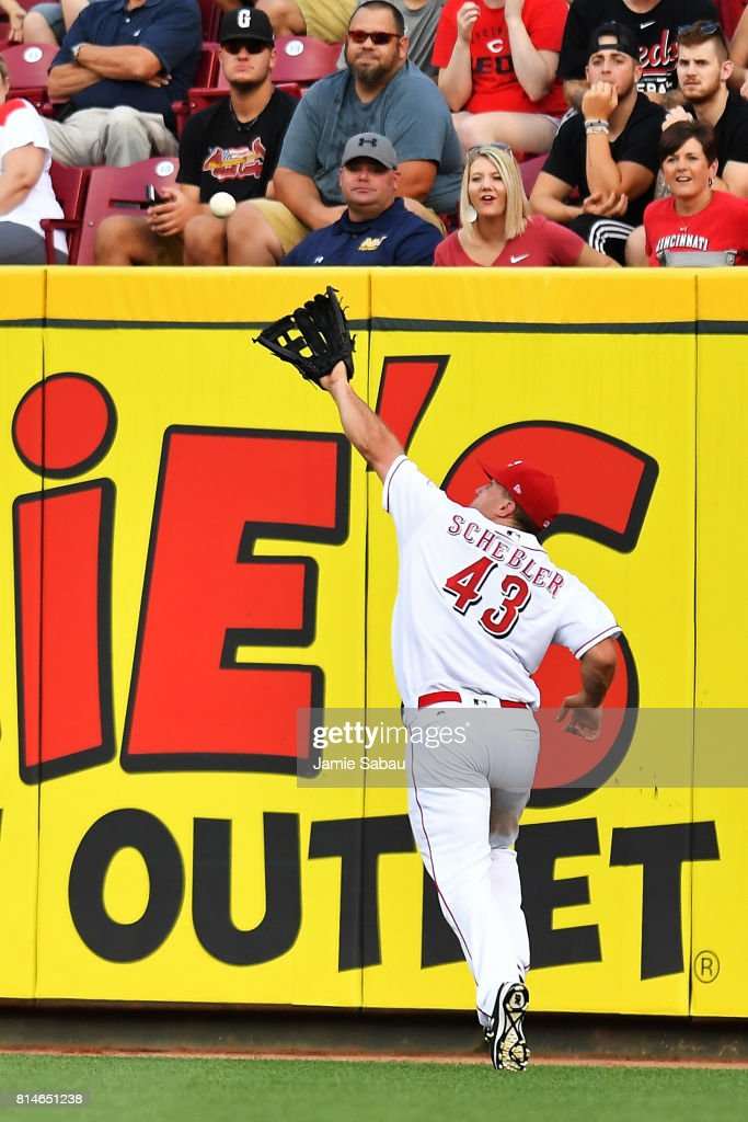 Scott Schebler #43 of the Cincinnati Reds makes an over-the-shoulder catch of a fly ball in the fourth inning against the Washington Nationals at Great American Ball Park on July 14, 2017 in Cincinnati, Ohio. Washington shut out Cincinnati 5-0.