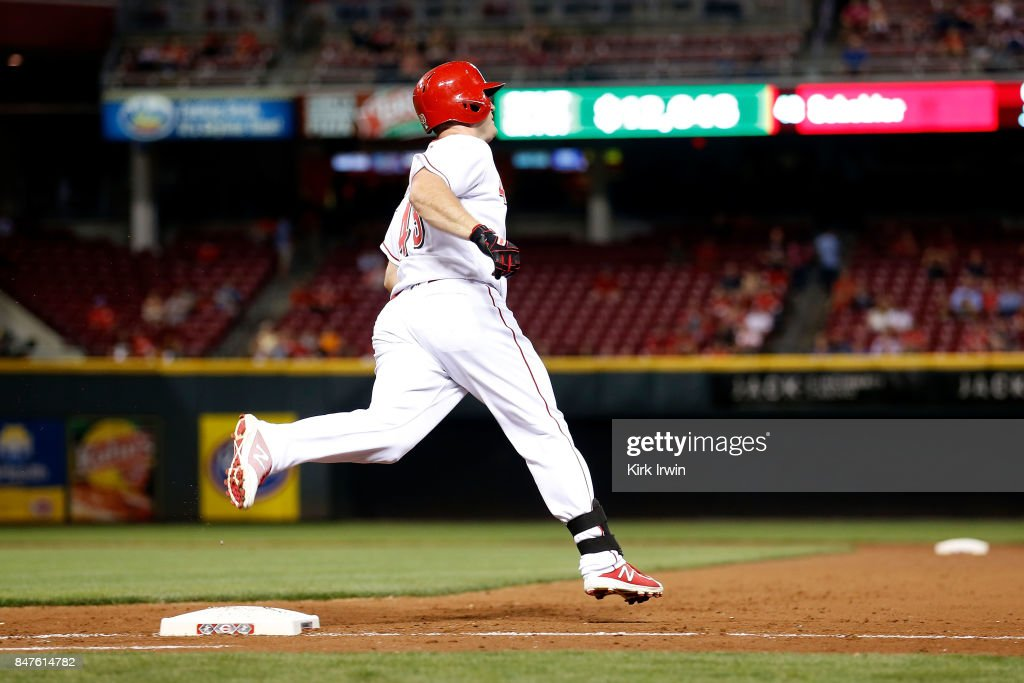 Scott Schebler #43 of the Cincinnati Reds rounds first base after hitting a home run during the fifth inning of the game against the Pittsburgh Pirates at Great American Ball Park on September 15, 2017 in Cincinnati, Ohio. Cincinnati defeated Pittsburgh 4-2.