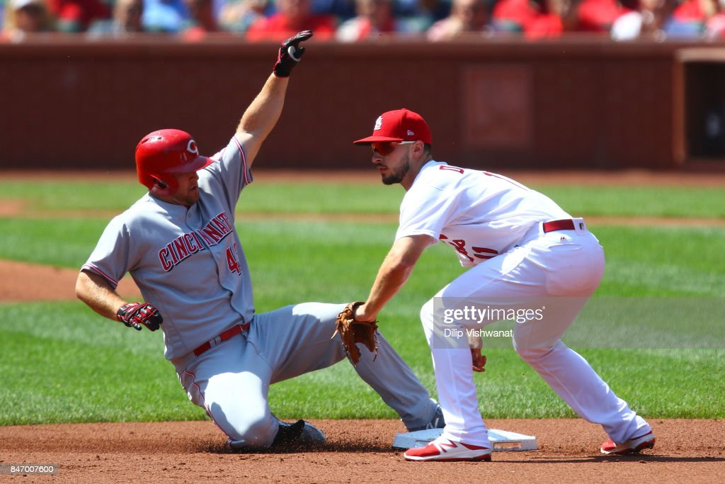 Scott Schebler #43 of the Cincinnati Reds slides safely into second base for a double against Paul DeJong #11 of the St. Louis Cardinals in the second inning at Busch Stadium on September 14, 2017 in St. Louis, Missouri.