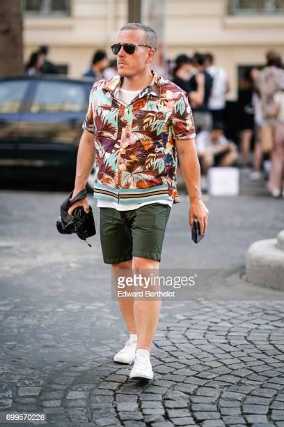 Scott Schuman The Sartorialist wears a flower print shirt green shorts white sneakers outside the Valentino show during Paris Fashion Week Menswear...