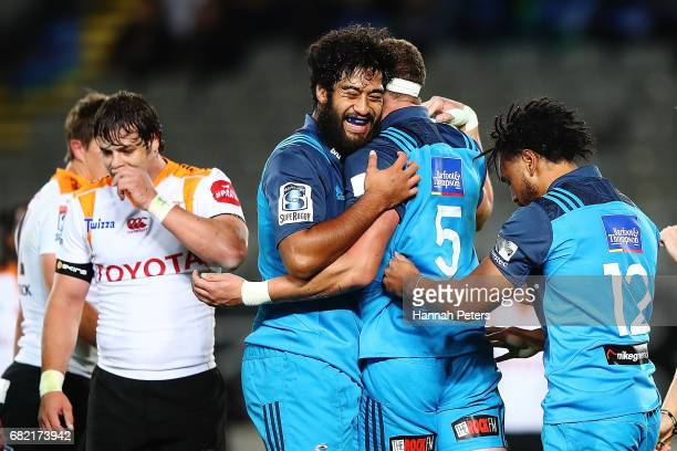 Scott Scranton of the Blues celebrates with Akira Ioane of the Blues after scoring a try during the round 12 Super Rugby match between the Blues and...