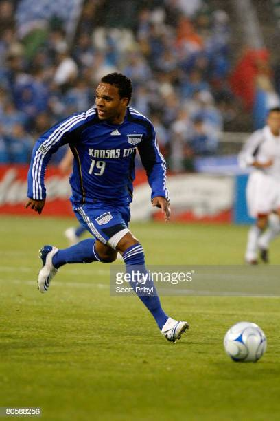 Scott Sealy of the Kansas City Wizards dribbles the ball against the New England Revolution during the game at Community America Ballpark on April 9...