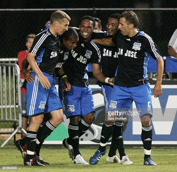 Scott Sealy of the San Jose Earthquakes celebrates with teammates after scoring a goal against New England Revolution in the MLS game at Buck Shaw...