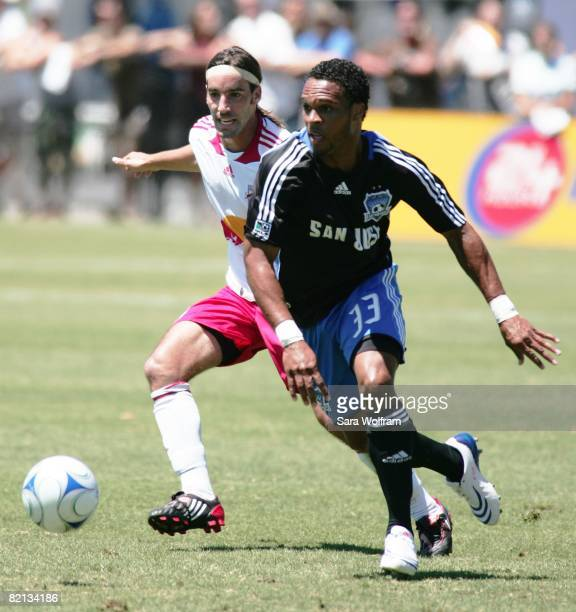 Scott Sealy of the San Jose Earthquakes controls the ball against Eric Brunner of the New York Red Bulls during the MLS game at Buck Shaw Stadium on...
