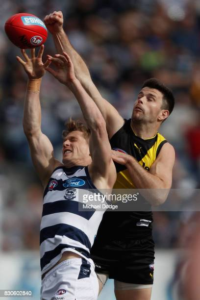 Scott Selwood of the Cats and Trent Cotchin of the Tigers compete for the ball during the round 21 AFL match between the Geelong Cats and the...