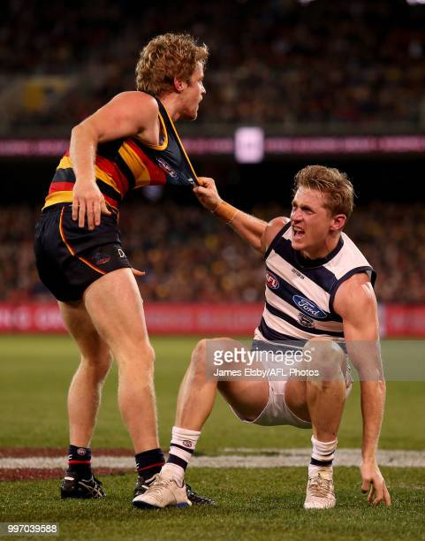 Scott Selwood of the Cats clashes with Rory Sloane of the Crows during the 2018 AFL round 17 match between the Adelaide Crows and the Geelong Cats at...