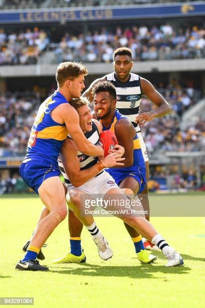 Scott Selwood of the Cats is tackled by Jack Redden and Willie Rioli of the Eagles during the 2018 AFL round 03 match between the West Coast Eagles...
