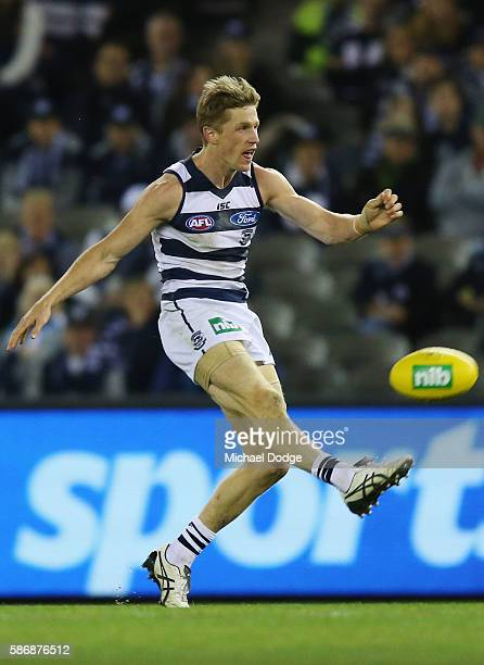 Scott Selwood of the Cats kicks the ball during the round 20 AFL match between the Geelong Cats and the Essendon Bombers at Etihad Stadium on August...
