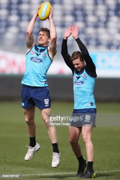 Scott Selwood of the Cats marks the ball in front of Mitch Duncan of the Cats during the Geelong Cats AFL training session at Simonds Stadium on...