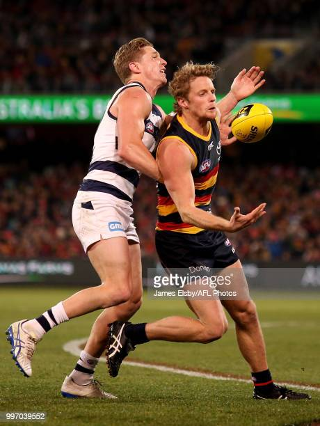 Scott Selwood of the Cats tackles Rory Sloane of the Crows during the 2018 AFL round 17 match between the Adelaide Crows and the Geelong Cats at...
