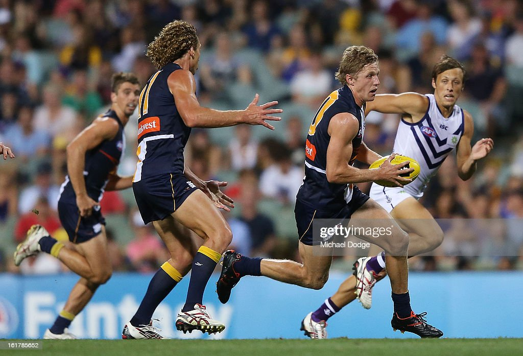 Scott Selwood of the West Coast Eagles runs with the ball during the round one NAB Cup match between the West Coast Eagles and the Fremantle Dockers at Patersons Stadium on February 16, 2013 in Perth, Australia.