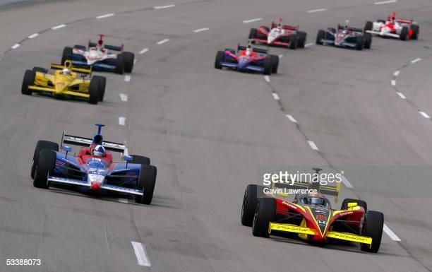 Scott Sharp driver of the Delphi Fernandez Racing Panoz Honda leads Dario Franchitti driver of the Andretti Green Racing Dallara Honda during the...