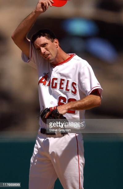 Scott Shields of the Angels wipes his brow on the mound in the first inning.