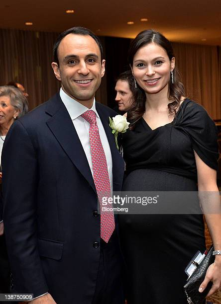 Scott Shleifer managing director of Tiger Global Management LLC left and wife Elena Shleifer stand for a photograph during the UJAFederation of New...