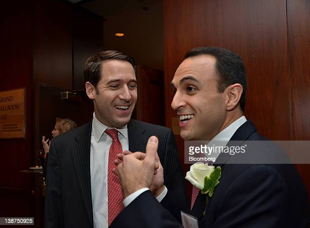 Scott Shleifer managing director of Tiger Global Management LLC right speaks with an attendee during the UJAFederation of New York Wall Street Dinner...
