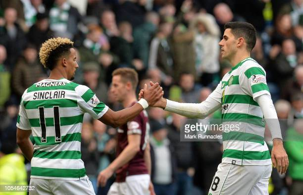 Scott Sinclair and team mate Tom Rogic of Celtic congratulate one another at the final whistle as Celtic beat Hearts 30 during the Betfred Scottish...