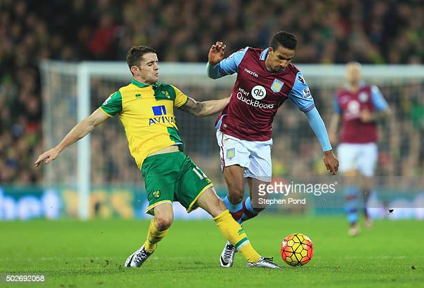 Scott Sinclair of Aston Villa and Robbie Brady of Norwich City compete for the ball during the Barclays Premier League match between Norwich City and...