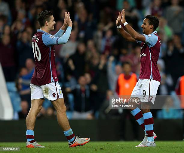 Scott Sinclair of Aston Villa celebrates scoring his hat trick with Jack Grealish during the Capital One Cup second round match between Aston Villa...