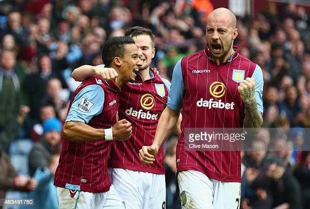 Scott Sinclair of Aston Villa celebrates scoring their second goal with Tom Cleverley and Alan Hutton of Aston Villa during the FA Cup fifth round...