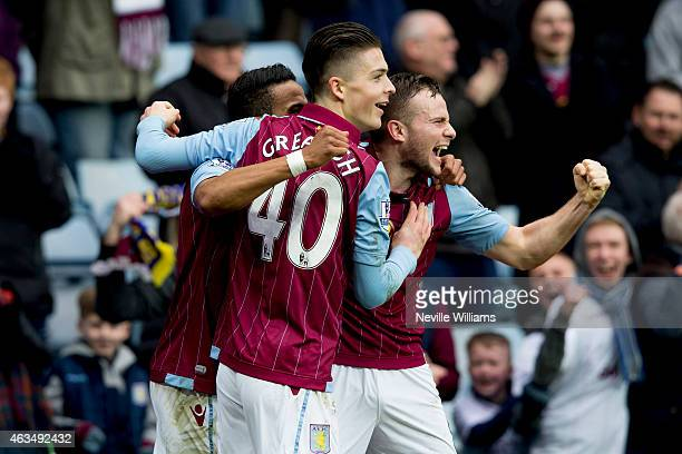 Scott Sinclair of Aston Villa celebrates with his teammates Jack Grealish and Tom Cleverley after scoring their second goal during the FA Cup Fifth...
