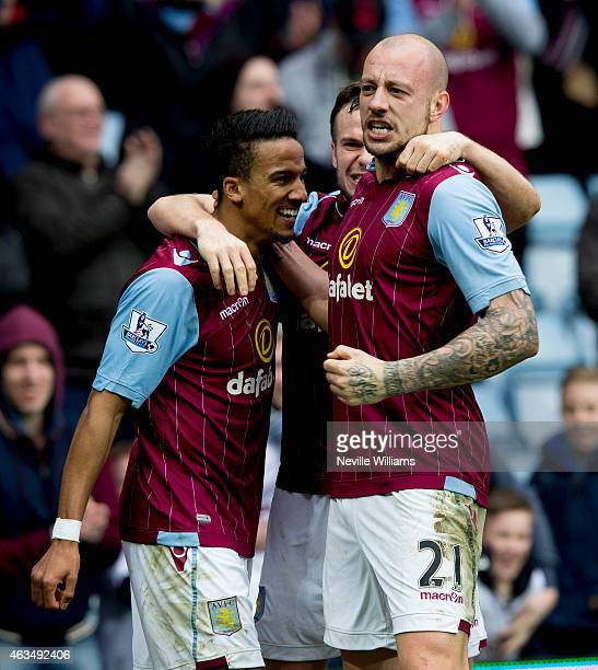 Scott Sinclair of Aston Villa celebrates with his teammates Tom Cleverley and Alan Hutton after scoring their second goal during the FA Cup Fifth...