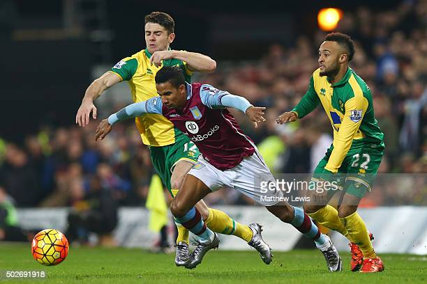Scott Sinclair of Aston Villa competes for the ball against Robbie Brady and Nathan Redmond of Norwich City during the Barclays Premier League match...