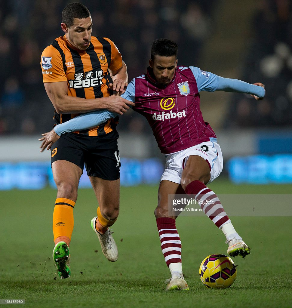 Scott Sinclair of Aston Villa is challenged by Jake Livermore of Hull City during the Barclays Premier League match between Hull City and Aston Villa at the KC Stadium on February 10, 2015 in Hull, England.