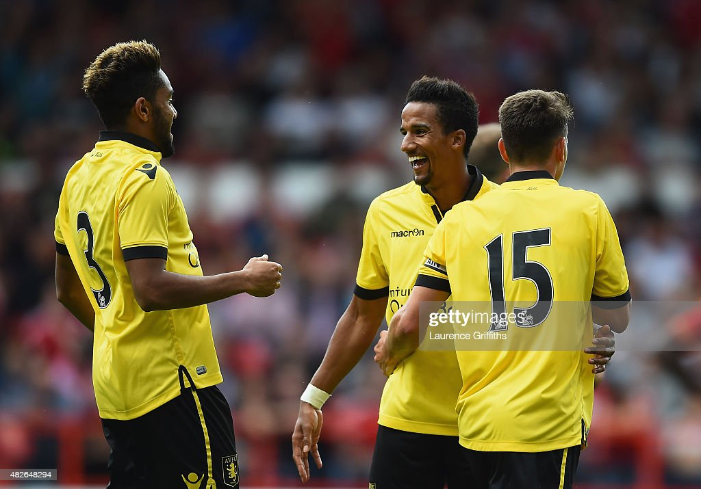 Scott Sinclair of Aston Villa is congratulated on scoring the third goal during the Pre Season Friendly match between Nottingham Forest and Aston Villa at City Ground on August 1, 2015 in Nottingham, England.