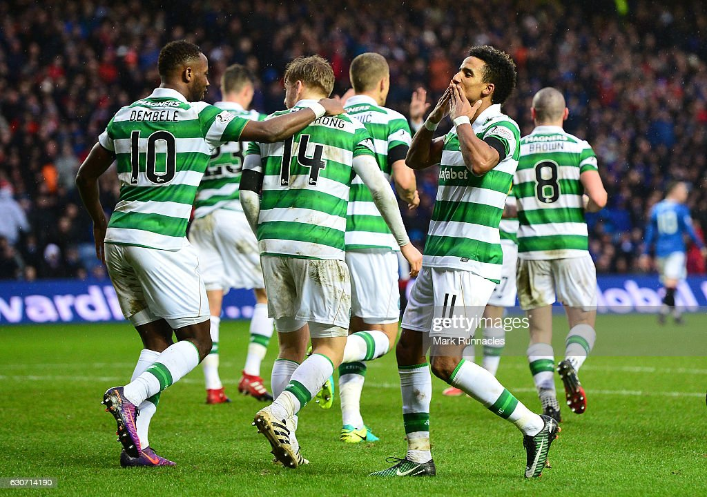 Scott Sinclair (L) of Celtic celebrates scoring his team's second goal during the Ladbrokes Scottish Premiership match between Rangers and Celtic at Ibrox Stadium on December 31, 2016 in Glasgow, Scotland.