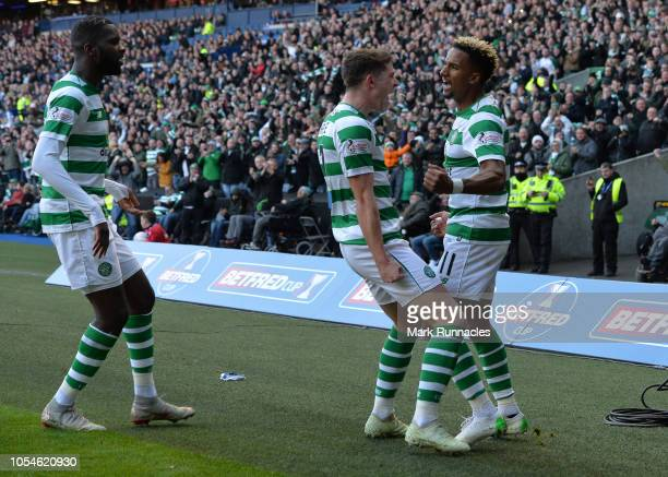 Scott Sinclair of Celtic celebrates with Ryan Christie after scoring his sides first goal during the Betfred Scottish League Cup Semi Final between...
