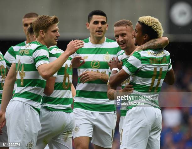Scott Sinclair of Celtic celebrates with team mates after scoring during the Champions League second round first leg qualifying game between Linfield...
