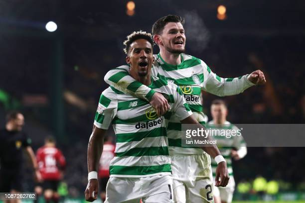 Scott Sinclair of Celtic celebrates with team-mate Oliver Burke after scoring their second goal from the penalty spot during the Ladbrokes Scottish...